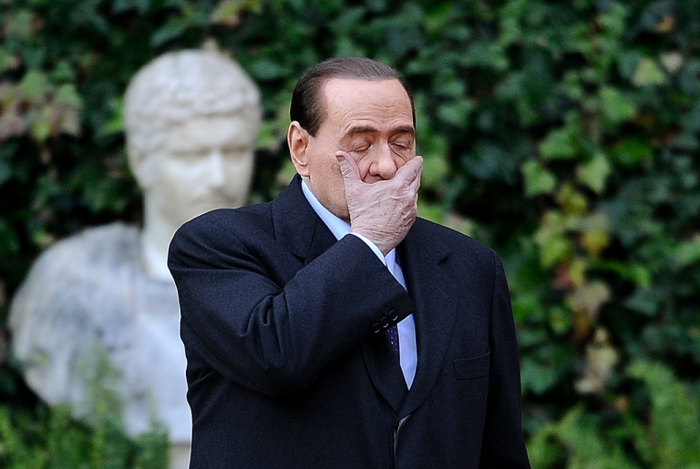 <p>Silvio Berlusconi: is he peering into the future in this photo taken earlier this year?</p>