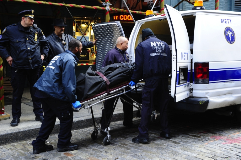 <p>Medical examiners remove the body of Mark Madoff, son of disgraced financier Bernard Madoff, after he hanged himself in his New York apartment on Dec. 11, 2010, the second anniversary of his father's arrest for perpetrating Wall Street's biggest ever fraud.</p>