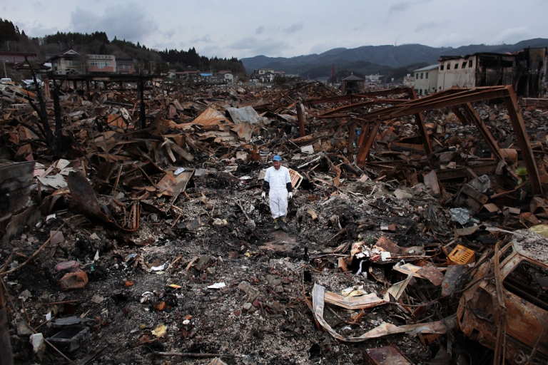<p>Sigo Hatareyama works to clean out what is left of his house on March 21, 2011 in Kesennuma, Japan. The 9.0 magnitude-strong earthquake struck offshore on March 11 at 2:46 p.m. local time, triggering a tsunami wave of up to ten meters that engulfed large parts of north-eastern Japan, and also damaged the Fukushima nuclear plant, threatening a nuclear catastrophe.</p>