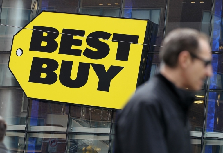 <p>A pedestrian walks by a Best Buy store on April 10, 2012, in New York City.</p>