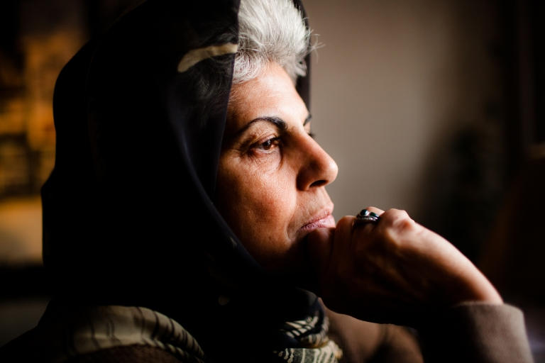 <p>Roshan Sirran, a women's rights advocate, in her office at the Training Human Rights Association for Afghan Women, in Kabul, Afghanistan on Dec. 19, 2011.</p>