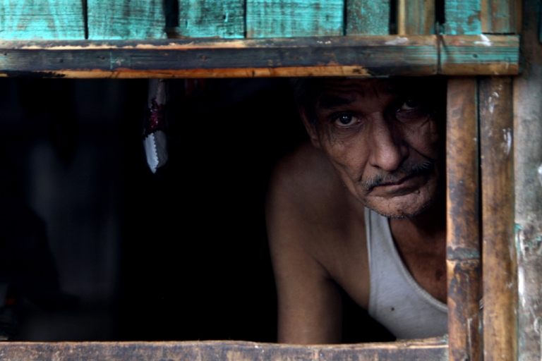 <p>A Bhutanese refugee shopkeeper looks out from his shop at The Beldangi II Refugee Camp some 300 kms southeast of Kathmandu on Oct. 6, 2009.</p>