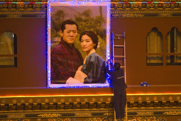 <p>A Bhutanese worker hangs lights on the portrait of the future King Jigme Khesar Namgyel Wangchuck, and Queen of Bhutan as Bhutan prepares for the royal wedding October 11, 2011, in Thimphu, Bhutan.</p>
