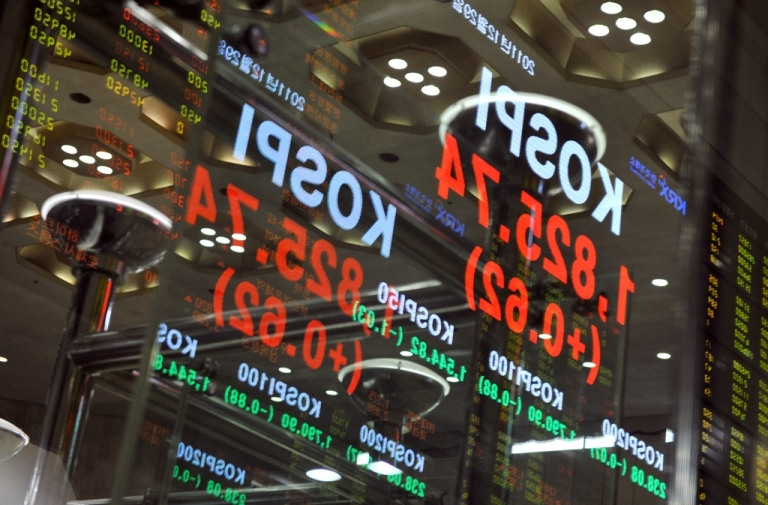 <p>The Korean stock index is reflected on glass on the final day of trading for 2011 at the Korea Exchange in Seoul on December 29, 2011. South Korea's stock market took a beating on April 4th, 2013 as worries increased over potential conflict with North Korea.</p>