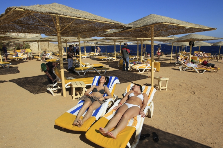 <p>Bikini-clad tourists enjoy the beach in the Red Sea resort town of Sharm el-Sheikh,. With ultra-conservatives poised to play a big role in Egyptian parliament during an economic crisis, the Islamists' thoughts on what tourists may wear or drink are being scrutinised amid fears they will harm the country's vital tourism industry.</p>