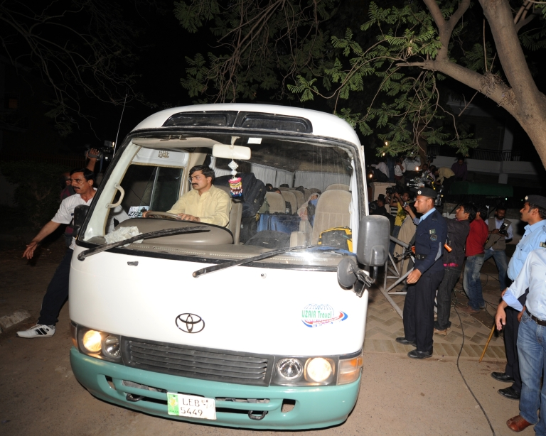 <p>Pakistani policemen escort a minivan carrying family members of slain al Qaeda chief Osama bin Laden in Islamabad, as they leave for the airport before their departure to Saudi Arabia on April 26, 2012.</p>