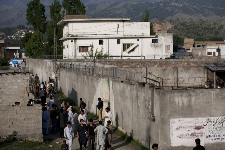 <p>People gather outside Osama Bin Laden's compound, where he was killed during a raid by US special forces, May 3, 2011 in Abottabad, Pakistan. Bin Laden's wives will be deported from Pakistan next week, according to their lawyer.</p>