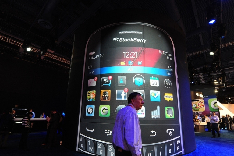 <p>A man walks past a BlackBerry display at the International Consumer Electronics Show (CES) in Las Vegas, Nevada, on January 11, 2012. Although BlackBerry is losing market share in the US, it remains a strong brand in South Africa and Nigeria.</p>