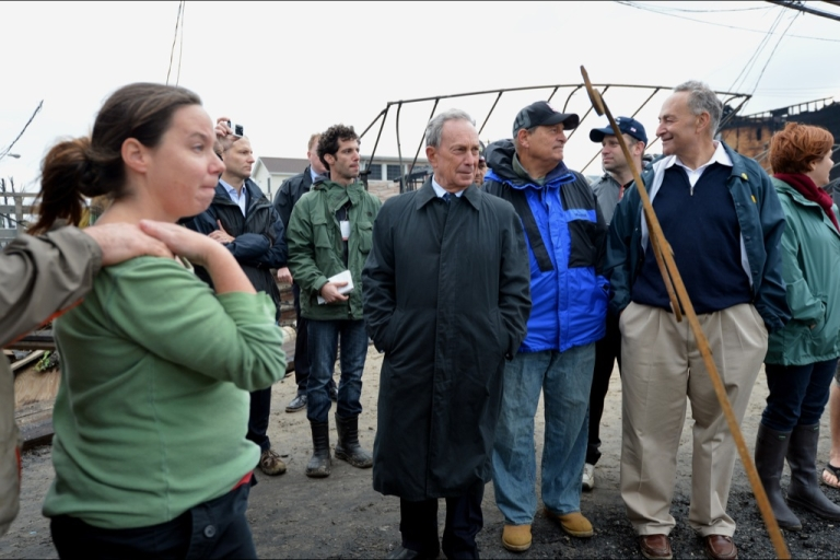 <p>New York City Mayor Michael Bloomberg (C), US Senator Charles Schumer (2nd R) and New York City Council Speaker Christine Quinn (R) view hurricane damage in the Breezy Point area of Queens on October 30, 2012 after fire destroyed about 80 homes.</p>