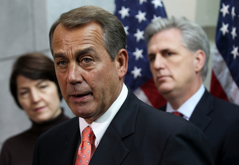 <p>US Speaker of the House Rep. John Boehner (R-Ohio) (C) speaks as Rep. Cathy McMorris Rodgers (R-Wash.) (L) and House Majority Whip Rep. Kevin McCarthy (R-Calif.) listen following a Republican Conference meeting on Capitol Hill on Dec. 16, 2011.</p>