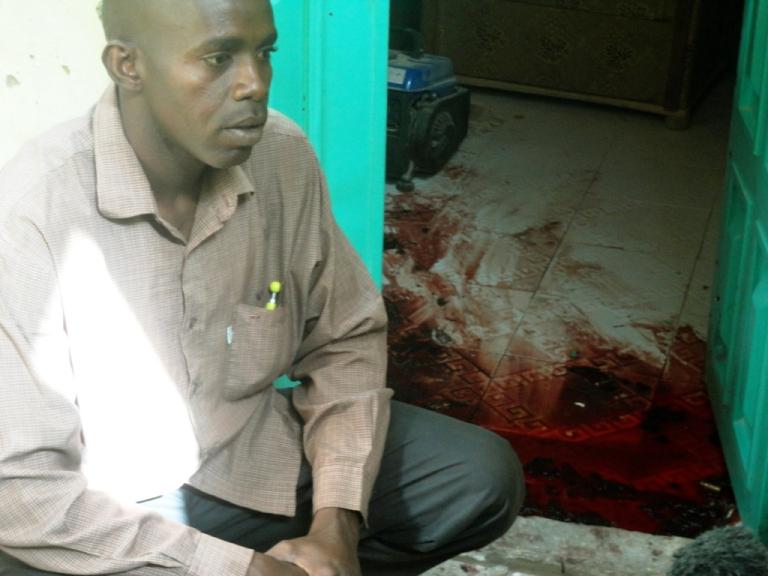 <p>Shehu Idris, a cousin of suspected member of the Nigerian Islamist group Boko Haram, Uzairu Abba Abdullahi, squats on Jan. 24, 2012 in his blood-stained home in the Tsamiyar Boka neighborhood of the northern Nigerian city of Kano.</p>