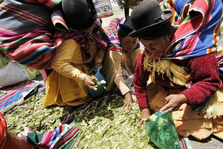 <p>Aymara women chew coca leaves in front of the U.S. Embassy to Bolivia on Jan. 26, 2011.</p>