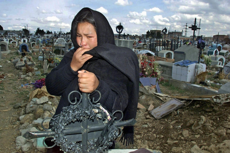<p>This Bolivian woman lost her husband and son when protesters clashed with anti-riot forces in October 2003, when the so-called