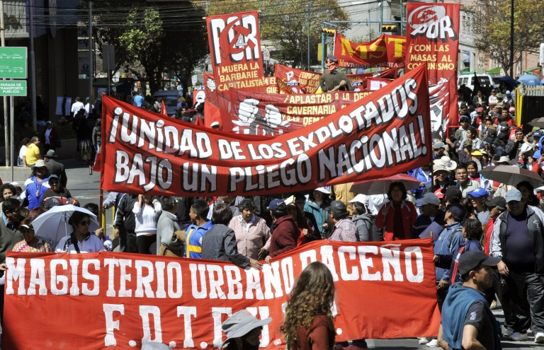 <p>Labor unions march in La Paz, Bolivia on May 1, Labor Day, ahead of President Evo Morales' announcement that Bolivia is taking control of the Spanish-run electrical grid.</p>