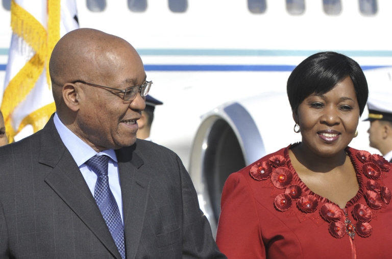 <p>South African President Jacob Zuma (L) and his fiancee Gloria Bongi Ngema (R) arrive at Incheon international airport outside Seoul on November 10, 2010 ahead of the start of the G20 Summit.</p>