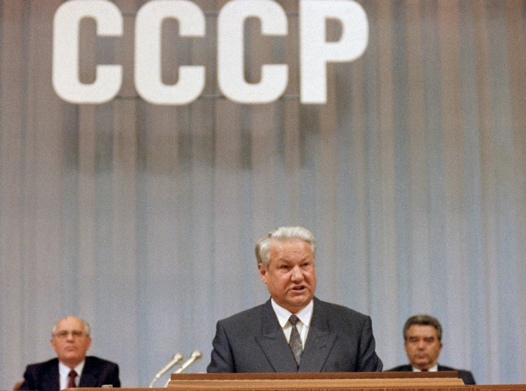 <p>Russian President Boris Yeltsin addresses the deputies at the People's Congress in Moscow, as Soviet President Mikhail Gorbachev (left) listens in the background, on Sept. 3, 1991.</p>