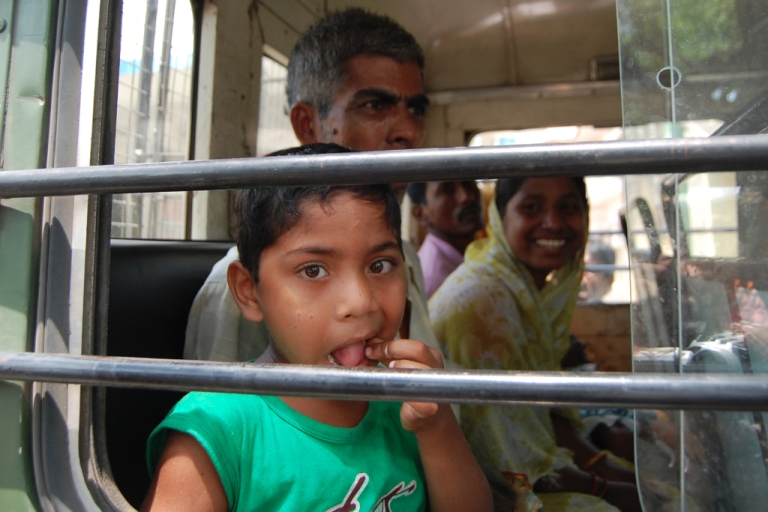 <p>Five year old Indian boy Ariful Sheikh (C), sits in a police van with his family shortly after his release from a Bangladesh jail, in Krishnaganj village, some 15 kilometers inside the Indo-Bangla border upon his return to India. A five-year-old Indian boy left a jail in Bangladesh on April 29, after being incarcerated for more than a year when he was picked up by police on the border along with his grandparents.</p>