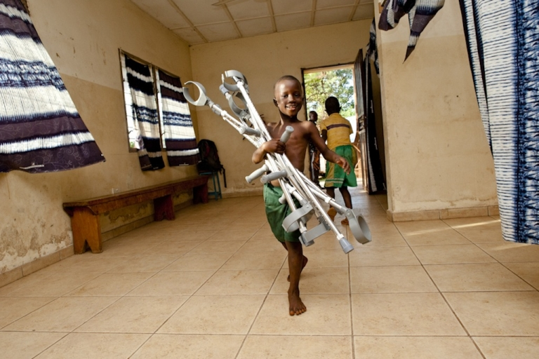 <p>Operation Rise, run by an American organization called The Peace Project, handed out crutches on Sept. 21, 2011, to landmine victims, polio sufferers and amputees from the brutal decade-long civil war in Sierra Leone.  A boy carries some new crutches at one of the Operation Rise distribution centers in Aberdeen, Freetown.</p>