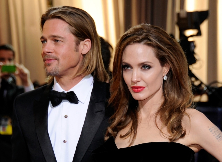 <p>Brad Pitt and Angelina Jolie arrive at the 84th Annual Academy Awards at the Hollywood &amp; Highland Center in February.</p>