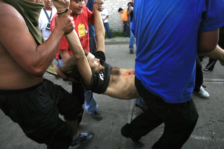 <p>Members of the Oaxaca People's Popular Assembly (APPO) try to help US cameraman Brad Will after he was shot, in Oaxaca, Mexico, Oct. 27, 2006. Will and a teacher were shot dead during violent uprisings. Mexico authorities announced Wednesday the arrest of a new suspected killer.</p>