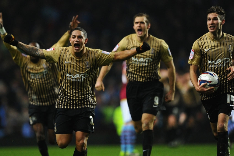 <p>Nathan Doyle and his Bradford City teammates celebrate reaching the Capital One Cup final after beating Aston Villa on January 22, 2013 in Birmingham, England.</p>