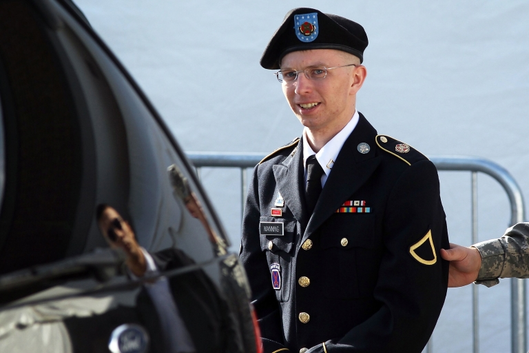 <p>US Army Private Bradley Manning is escorted as he leaves a military court at the end of the first of a three-day motion hearing June 6, 2012, in Fort Meade, Md.</p>