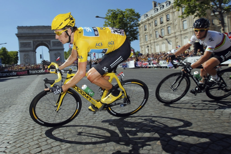 <p>Bradley Wiggins of Team Sky leads teammate Mark Cavendish around the Arc de Triomphe during the final stage of the 2012 Tour de France on July 22, 2012, in Paris.</p>