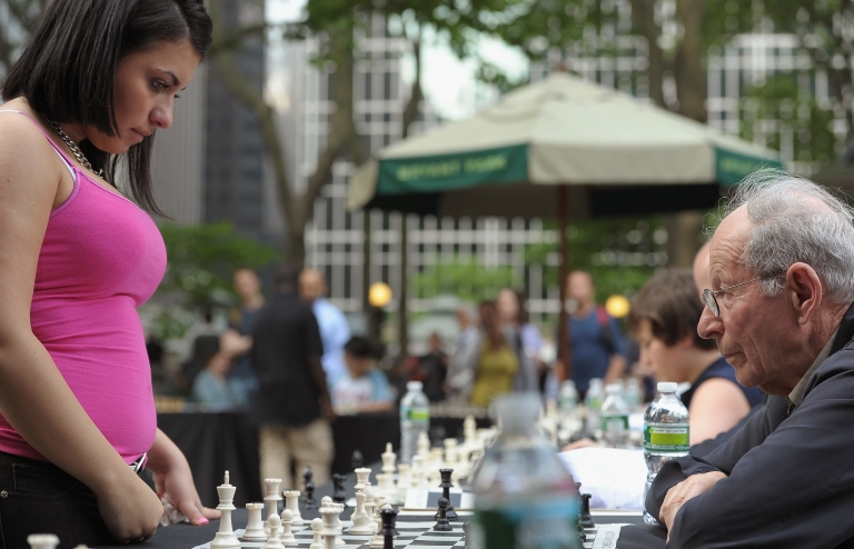 <p>Alena Kats and Emanuel Grunfeld face off in the HBO Bryant Park Chess Challenge in New York City's Bryant Park on May 24, 2011.</p>
