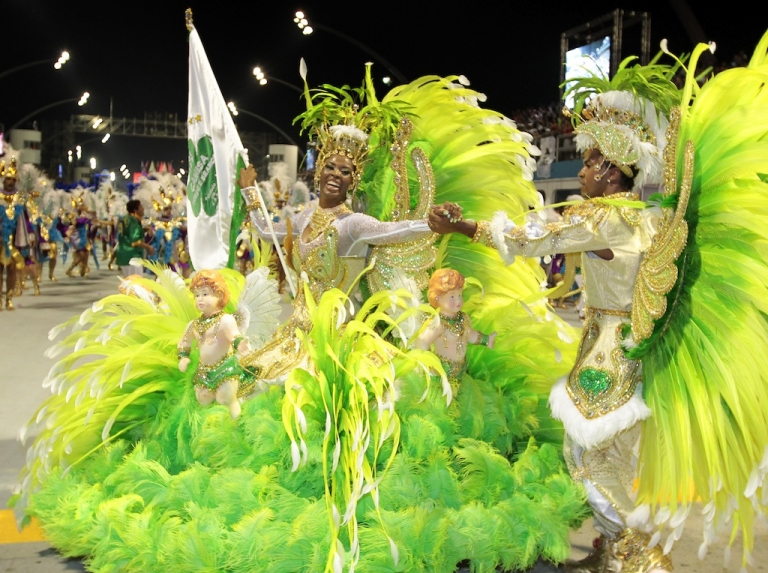 <p>Revellers of Camisa Verde e Branco samba school dance during the opening night of parades at the Sambódromo, as part of Carnival celebrations in São Paulo early on February 18, 2012.</p>