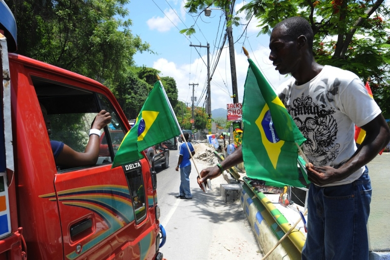 <p>A Haitian man sells flags of Brazil, one of the countries taking part in the World Cup soccer in South Africa on June 10, 2010 in the streets of Petion-ville, Haiti.</p>