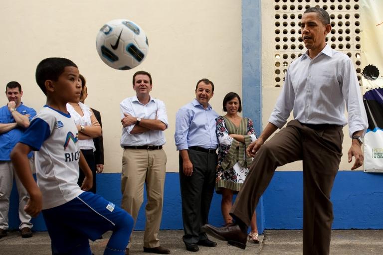 <p>U.S. President Barack Obama plays soccer with some children while visiting Ciudad de Dues Favela in Rio de Janiero, Brazil, March 20, 2011.</p>