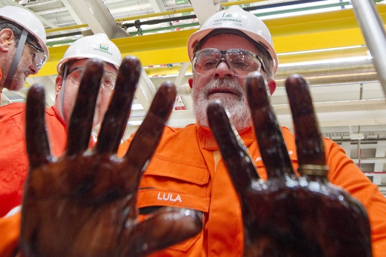 <p>Brazil's President Luiz Inacio Lula da Silva shows his hands, dirty with the first extraction of pre-salt oil in the Tupi oil field basin, Oct. 28, 2010.</p>