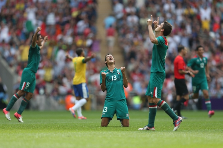 <p>Diego Reyes of Mexico falls to his knees and celebrates winning the goal medal after victory in the Men's Football Final between Brazil and Mexico at the London 2012 Olympic Games on Aug. 11, 2012.</p>