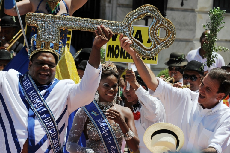 <p>Carnival King Momo (L) gets from Rio's mayor Eduardo Paes (R) the keys to the city during the official launching of the 2012 Carnival in Rio de Janeiro, Brazil, on February 17, 2012. AFP PHOTO/VANDERLEI ALMEIDA (Photo credit should read VANDERLEI ALMEIDA/AFP/Getty Images)</p>