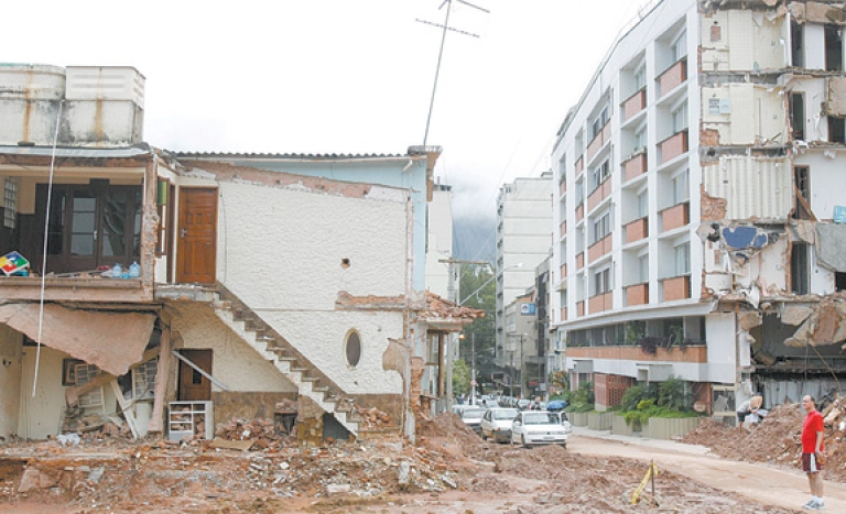 <p>Mud and debris still choke the streets of Nova Friburgo, one of the Brazilian cities devastated by deadly landslides in January.</p>
