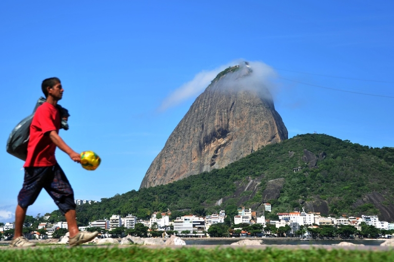 <p>A man walks along Brazil's Botafogo beach on April 10, 2012.</p>