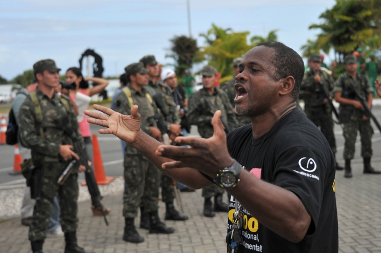 <p>A demonstrator shouts to militarymen blocking the access to the Legislative Assembly building, which is being occupied by policemen on strike in Salvador, Bahia, Brazil. Police strikers occupying the state legislature in the Brazilian city of Salvador vowed Monday to resist if troops try to evict them amid escalating violence.</p>