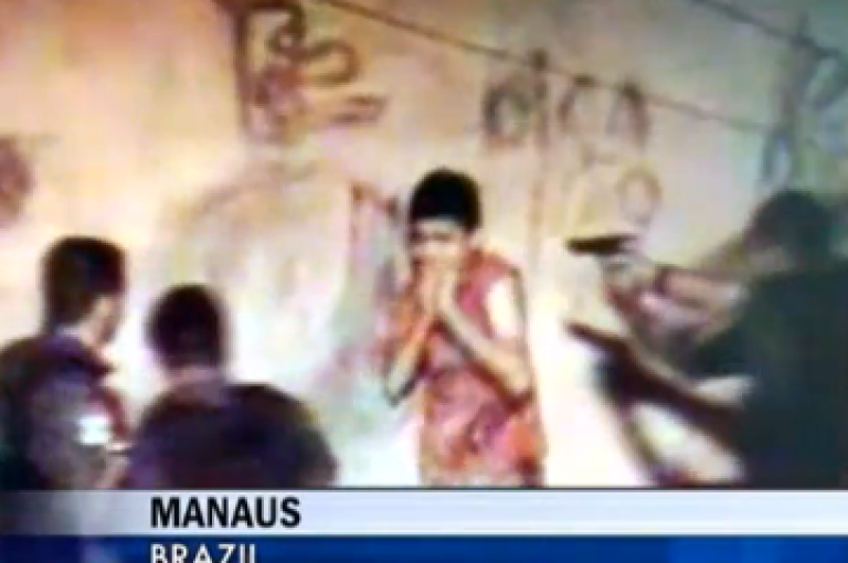 <p>Screen grab of raw footage taken from YouTube shows Brazilian police about to shoot a teenager in Manaus, Brazil.</p>