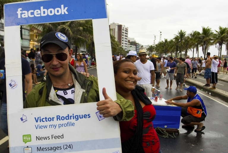 <p>A reveller dressed as a Facebook profile joins a parade in Rio de Janeiro on March 5, 2011.</p>