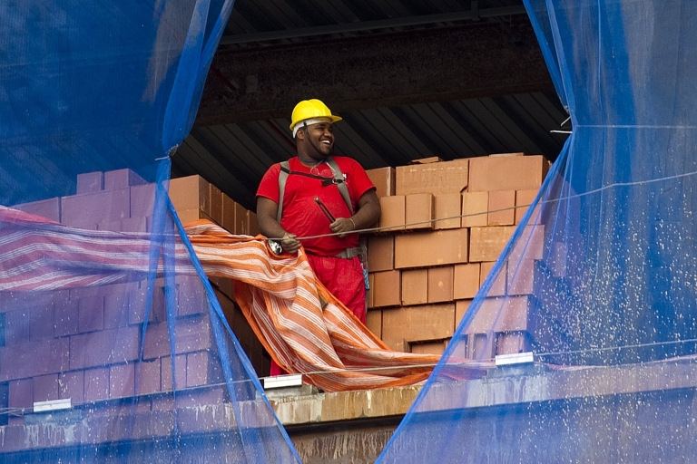 <p>All smiles? Not quite. Brazil's economy is not growing like it was, so workers like this builder in Rio de Janeiro could become a bit less cheerful.</p>