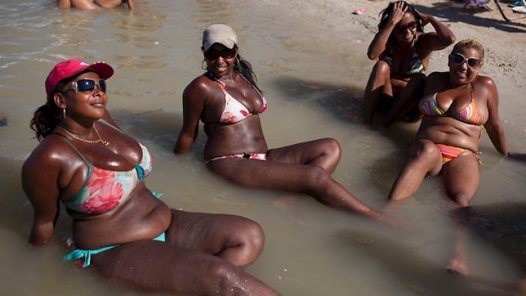 <p>Bikini-clad women sunbathe at the artificial lake Piscinao de Ramos in Rio de Janeiro, Brazil.</p>