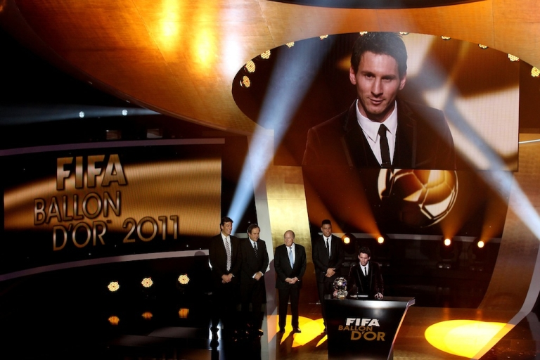 <p>Lionel Messi of Barcelona receives the FIFA Ballon d'Or 2011 trophy on January 9, 2012 in Zurich, Switzerland.</p>