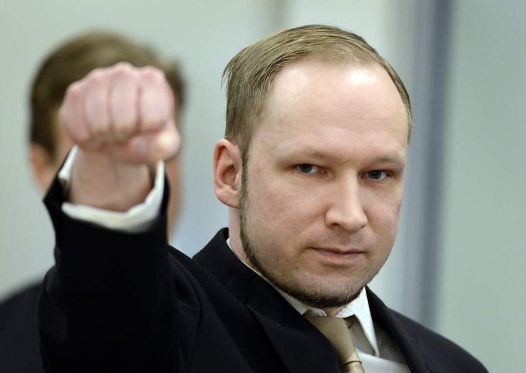 <p>Rightwing extremist Anders Behring Breivik, who killed 77 people in twin attacks in Norway last year, makes a farright salute as he enters the Oslo district courtroom at the opening of his trial on April 16, 2012. Breivik told the Court that he did not recognise its legitimacy. Since Breivik has already confessed to the deadliest attacks in post-war Norway, the main line of questioning will revolve around whether he is criminally sane and accountable for his actions, which will determine if he is to be sentenced to prison or a closed psychiatric ward.</p>