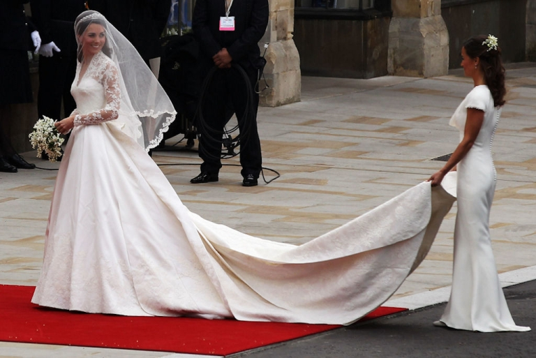 <p>Kate Middleton looks back at her maid of honor, sister Pippa, after arriving at Westminster Abbey in London, England for her wedding to Prince William on April 29, 2011. Her dress is by Sarah Burton for Alexander McQueen.</p>