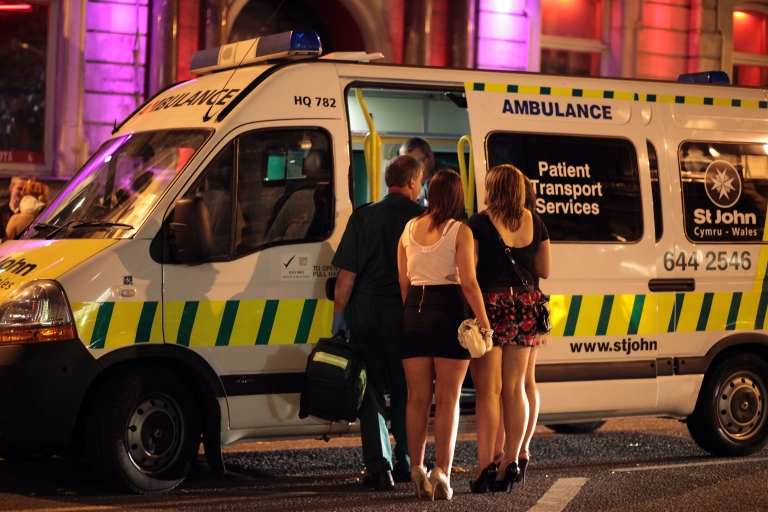 <p>British girls talk to a friend who is being treated in a ambulance parked outside a night spot in Cardiff city, Wales, on July 24, 2010. The Coalition government is widely expected to introduce new laws to give increased powers for local councils to curb binge drinking and to take action in areas plagued by alcohol-influenced crime and disorder. The previous government controversially introduced 24-hour licensing in 2005 when it was hoped would introduce a cafe culture society to British cities, but critics have claimed it has lead to wide spread binge drinking and a marked increase in violent disorder.</p>