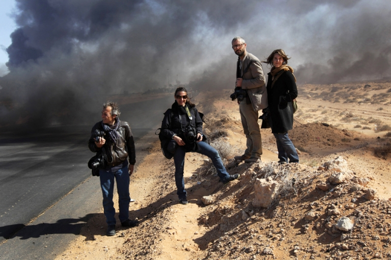 <p>Four New York Times journalists, the Beirut bureau chief Anthony Shadid, photographers Tyler Hicks and Lynsey Addario (pictured above in the middle) and a reporter and videographer, Stephen Farrell went missing for three days in March 2011, were reportedly taken by loyalist Libyan forces. Two British journalists who worked for Iran's Press TV have been detained in Libya by the Misrata Brigade.</p>
