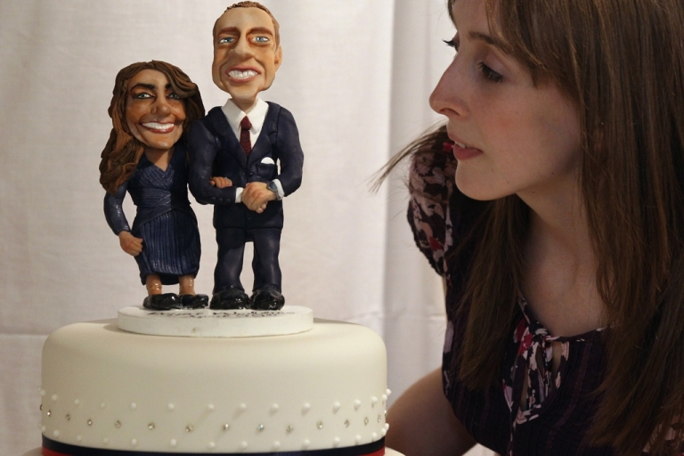 <p>A woman admires a cake featuring figures of Prince William and Kate Middleton at an exhibition of Royal Wedding cakes on April 21, 2011 in London, England. The cake features in the 'Let Them Eat Cake' exhibition inside Wellington Arch on Hyde Park Corner.</p>