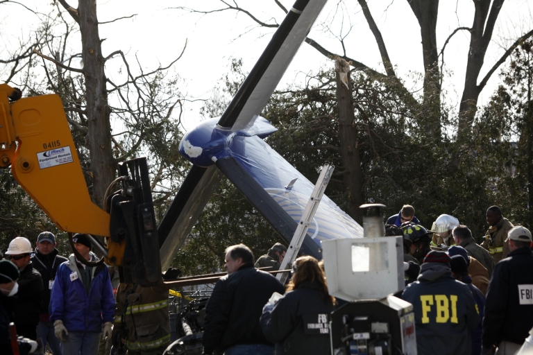 <p>Workers and investigators clear debris from the scene of the plane crash of Continental Connection Flight 3407 in Clarence, NY, on Feb. 16, 2009. The Bombardier Dash 8 Q400 crashed on approach to Buffalo Niagara International Airport on Feb. 12, 2009, killing all 49 people on the plane and one on the ground.</p>