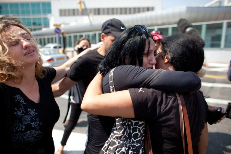 <p>The sisters of a woman who was killed during an attack in Bulgaria mourn as they wait for their wounded relatives at the Ben Gurion International Airport on July 19, 2012 near Tel Aviv, Israel.</p>