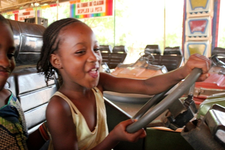 <p>A little girl has a blast on the bumper cars at Manuel Marco's Parko de Corinhog do Choque in Guinea-Bissau.</p>